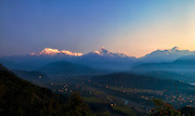 First light in the Himalayas. Machapuchare and the Annapurnas can be seen.