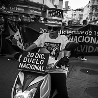 To conmemorate the 27 anniversary of the US Invasion to Panama on December 20 of 1989, a group of independent associations march in the streets of downtown Panama city to protest the lack of actual final and formal information on what really happen on the US Invasion to Panama and for the Goverment to declare December 20 an official day of mourning for the country.  Dec. 20, 2016. Photo by:  Tito Herrera.