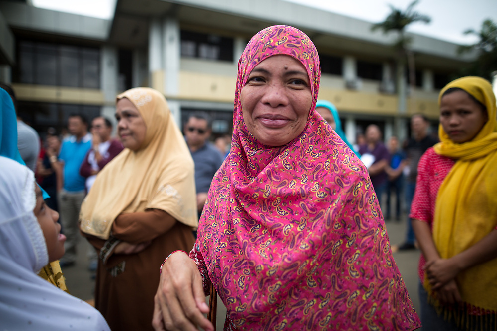 MARAWI, PHILIPPINES - JUNE 12: Muslim residents smile before a symbolic flag raising ceremony in celebration of the Independence Day in Marawi City, Philippines on June 12, 2017. As fighting rages on for the third week, police hung Philippine flags  around war torn Marawi to boost troop morale. (Photo: Richard Atrero de Guzman/NUR Photo)<br />  <br /> <br /> <br /> Residents in tears during Lanao Del Sur Vice Governor Mamintal Adiong's emotional address to the displaced families of Marawi. Local executives and citizens gathered for a symbolic flag raising ceremony to assert civilian authority and unity in celebration of Independence Day in Marawi City, Philippines on June 12, 2017. (Photo: Richard Atrero de Guzman/NUR Photo)