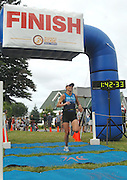 Penny Himes of Elkhart, Indiana wins the overall female title at the inaugural Little Traverse Triathalon in Harbor Springs, Michigan.