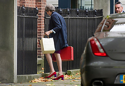 © Licensed to London News Pictures. 16/10/2017. London, UK. Prime Minister Theresa May is seen entering Downing Street by the back door. Later Mrs May and Brexit Secretary David Davis will have dinner with EU chief negotiator Michel Barnier and Commission chief Jean-Claude Juncker in Brussels after Brexit talks were described as being in deadlock. Photo credit: Ben Cawthra/LNP