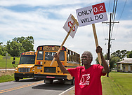Robert Taylor founder of the Concerned Citizens Of St John protests with  near a school in Reserve LA, where they hope to bring awareness of the danger of  high levels of chloroprene emissions being emitted by Denka/Dupont in St. John the Baptist Parish. The levels emitted in the area are much higher than  the recommended EPA  standard for chloroprene, a likely human carcinogen.