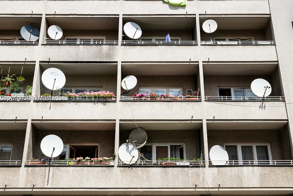 Satellite dishes on balconies of social housing apartment building in Neukolln Berlin Germany