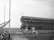 Derry jumps high to attempt to save the ball from going over the bar during the All Ireland Senior Gaelic Football final Dublin vs Derry in Croke Park on 28th September 1958. Dublin 2-12 Derry 1-9.