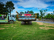 08 NOVEMBER 2017 - NONG SAENG, NAKHON NAYOK, THAILAND: Workers load a rice harvesting machine onto a trailer to move it to a field during the 2017 rice harvest in Nakhon Nayok province. Thailand is the second leading rice exporter in the world and 16 million Thais work in the rice industry.      PHOTO BY JACK KURTZ
