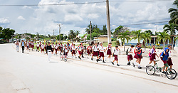 22 September 2015, Caletón, Cuba: School children march to the central square in Caletón.