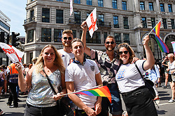 © Licensed to London News Pictures. 07/07/2018. LONDON, UK. England fans in the capital to watch the England v Sweden World Cup football match view the annual Pride in London Parade, the largest celebration of the LGBT+ community in the UK.  Photo credit: Stephen Chung/LNP