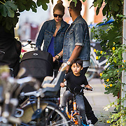 NLD/Amsterdam/20140902 - Douten Kroes with husband Sunnery James en kinderen wandelend