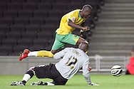 Milton Keynes - Tuesday, August 12th, 2008: Willy Gueret of MK Dons is beaten to the ball by Omar Koroma of Norwich City during the Carling League Cup First Round match at Stadium MK, Milton keynes. (Pic by Mark Chapman/Focus Images)