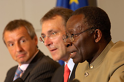 BRUSSELS, BELGIUM - JUNE-07-2006 - LEFT TO RIGHT:  Dr Martin Bartenstein, Austrian Minister of Economics and Labour, and President of the EU Energy Council - Andris Piebalgs, European Commissioner for Energy and Dr. Edmund Maduabebe Daukoru, Nigerian Minister of State for Petroleum Resources, and OPEC Conference President - OPEC ministers and representatives of the European Union hold a joint press conference after their meeting in Brussels where they discussed  a variety of issues including oil prices, market stability,  and oil production and supply. (PHOTO © JOCK FISTICK)