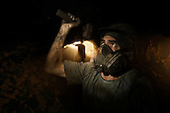 Ametista do Sul, RS, Brazil, 28/02/2008, 09h53: Searching for amethyst, a semiprecious stone, miners dig tunnels through the mountains in southern Brazil. This kind of mining is known for its  harmful dust.  The silicon dioxide particles can trespass the filter masks causing silicosis disease. Over 50% of amethyst miners had developed the silicosis, a disease that has only one cure: Lung transplant..(photo: Caio Guatelli)