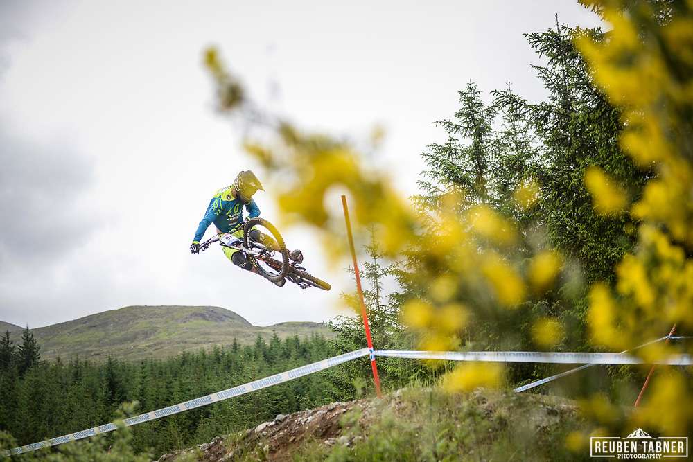 Magnus Manson goes sideways over the table tops during his practise run at the UCI Mountain Bike World Cup in Fort William.