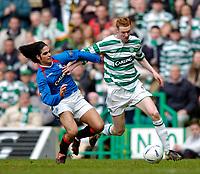 Photo. Jed Wee., Digitalsport<br /> Glasgow Celtic v Glasgow Rangers, Scottish FA Cup, Celtic Park, Glasgow. 07/03/2004.<br /> Celtic's Stephen Pearson (R) holds off Rangers' Mikel Arteta.