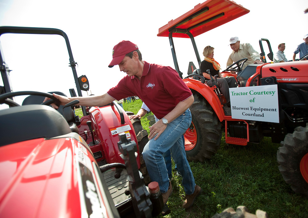St.Thomas, Ontario ---10-09-21--- Ontario Premier Dalton McGuinty boards a tractor Tuesday, September 21, 2010 as he and the other provincial party leaders (NDP leader Andrea Horwath in back) got a chance to plow a furrow at the 2010 International Plowing match in St. Thomas, Ontario.<br /> GEOFF ROBINS The Globe and Mail