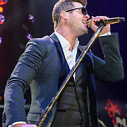 WASHINGTON, D.C. - December 16th, 2013 - Robin Thicke performs onstage during Hot 99.5's Jingle Ball 2013, presented by Overstock.com, at Verizon Center on December 16, 2013 in Washington, D.C. (Photo by Kyle Gustafson / For The Washington Post)