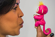 Fingerlings Baby Monkees respond to human interaction, demonstrated by Lauren DeLord on the Jazwares stand - The London Toy Fair opens at Olympia exhibition centre. Organised by the British Toy and Hobby Association it is the only dedicated toy, game and hobby trade exhibition in the UK. It runs for three days, with more than 240 exhibiting companies ranging from the large internationals to the new start up companies.