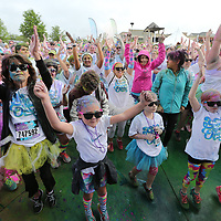 People from all over North Mississippi begin dancing as the annual Color Vibe 5K Run is about to get started on Saturday.