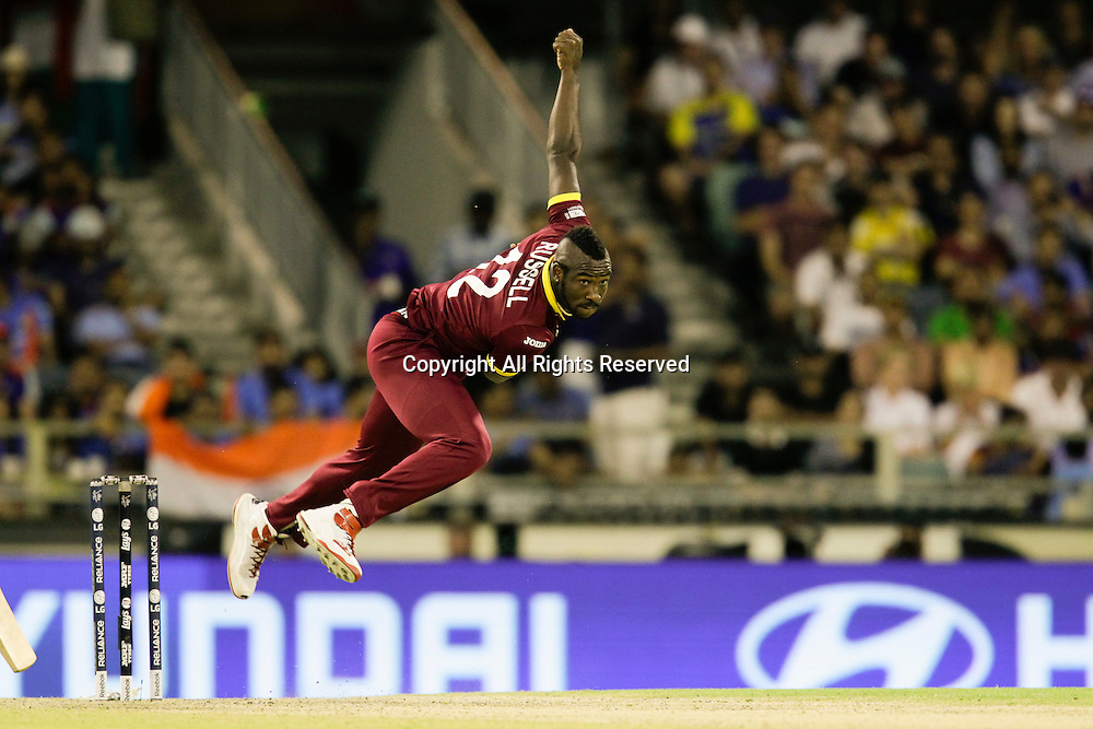 06.03.2015. Perth, Australia. ICC Cricket World Cup. India versus West Indies. Andre Russell looks a menacing sight as he bowls against the Indians.