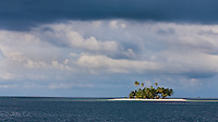 Sun beam in heavy weather highlights solitary island in the San Blas, panama