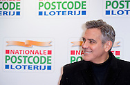 AMSTERDAM - George Clooney, actor and fighter for human rights, arrives on the red carpet prior to the Good Money Gala of the Postcode Lottery in the Royal Theatre Carré. Clooney is present as chief guest on behalf of his organization Not On Our Watch who is committed to stop underexposed human rights violations in the world COPYRIGHT ROBIN UTRECHT