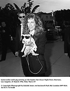 Gatecrasher with pig arriving at the Vanity Fair Oscar Night Party Mortons,  Los Angeles. 25 March 1996. Film. 96211/19<br /> <br /> © Copyright Photograph by Dafydd Jones<br /> 66 Stockwell Park Rd. London SW9 0DA<br /> Tel 0171 733 0108