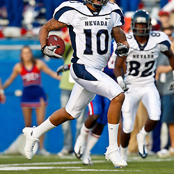 December 4, 2010; Ruston, LA, USA;  Nevada Wolf Pack quarterback Colin Kaepernick (10) runs for a touchdown during the second half against the Louisiana Tech Bulldogs at Joe Aillet Stadium.  Nevada defeated Louisiana Tech 35-17. Mandatory Credit: Derick E. Hingle
