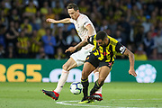 Manchester United Midfielder Nemanja Matic tackled by Watford forward Troy Deeney (9) during the Premier League match between Watford and Manchester United at Vicarage Road, Watford, England on 15 September 2018.