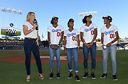 Jun 13, 2018; Los Angeles, CA, USA; ESPN broadcaster Jill Montgomery (left) interviews members of the NCAA champion Southern California Trojans women's 4 x 400m relay before a MLB game between the Texas Rangers and the Los Angeles Dodgers at Dodger Stadium. From left: Montgomery, Kendall Ellis (4), Deanna Hill (3), Anna Cockrell (2) and Kyra Constantine (1).