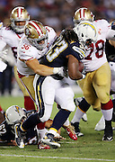 San Diego Chargers running back Gus Johnson (33) gets tackled by San Francisco linebacker Shayne Skov (56) as he runs the ball during the 2016 NFL preseason football game against the San Francisco 49ers on Thursday, Sept. 1, 2016 in San Diego. The 49ers won the game 31-21. (©Paul Anthony Spinelli)