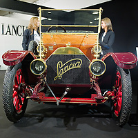PADOVA, ITALY - OCTOBER 27:  Two employees  of Lancia chat at the side of a vintage Lancia car on October 27, 2011 in Padova, Italy. The Vintage and Classic Cars Exhibition of Padova, running from the October 28 - 30, is the most important European trade show for vintage cars and motorbikes, showcasing over 1600 vehicles.