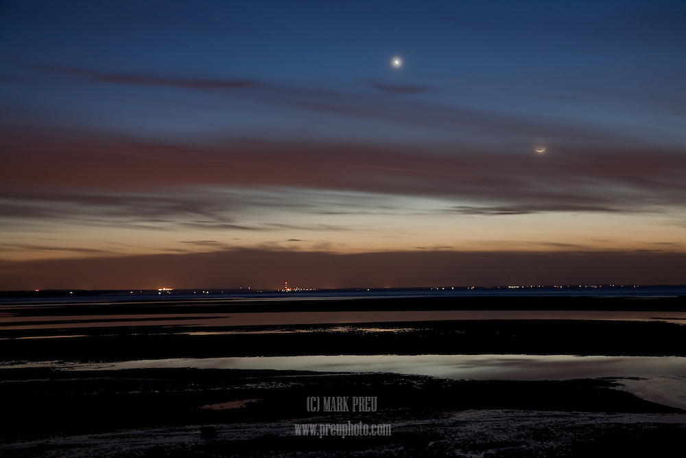The crescent moon and Venus hover over the last light of day at Chapin Beach in Dennis.