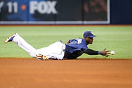 July 8, 2017 - St. Petersburg, Florida, U.S. - WILL VRAGOVIC   |   Times.Tampa Bay Rays shortstop Adeiny Hechavarria (11) knocks down the liner by Boston Red Sox catcher Sandy Leon (3) to end the top of the fifth inning of the game between the Boston Red Sox and the Tampa Bay Rays at Tropicana Field in St. Petersburg, Fla. on Saturday, July 8, 2017. (Credit Image: © Will Vragovic/Tampa Bay Times via ZUMA Wire)