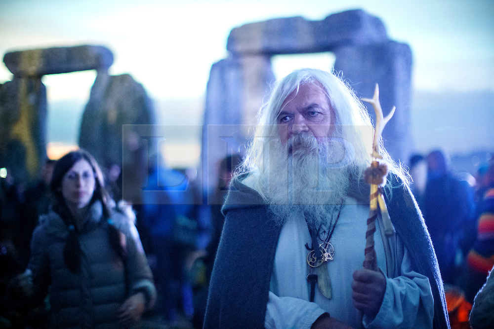 © Licensed to London News Pictures. 21/06/2015. Salisbury, UK. People prepare for the summer solstice dawn celebrations as druids, pagans and revellers gathered the night before the Summer Solstice sunrise at Stonehenge on June 21, 2015 in Wiltshire, England. Thousands of revellers gather at the 5,000 year old stone circle in Wiltshire to see the sunrise on the Summer Solstice dawn. The solstice sunrise marks the longest day of the year in the Northern Hemisphere. Photo credit: Tolga Akmen/LNP