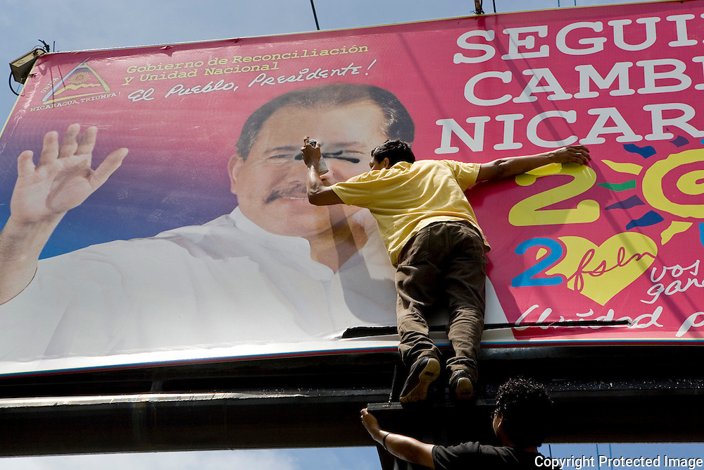 A Protestor at the Contra Ortega Protest, Nicaragua Spay paints a swastica on Ortegas face in the Contra Ortega Protest, Nicaragua