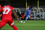 AFC Wimbledon midfielder Max Sanders (23)passing and crossing the ball during the Leasing.com EFL Trophy match between AFC Wimbledon and Leyton Orient at the Cherry Red Records Stadium, Kingston, England on 8 October 2019.