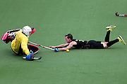 Hugo Inglis of New Zealand dives for a shot at goal. Glasgow 2014 Commonwealth Games. Hockey, Black Sticks Men v England, Glasgow Green Hockey Centre, Glasgow, Scotland. Tuesday 29 July 2014. Photo: Anthony Au-Yeung / photosport.co.nz