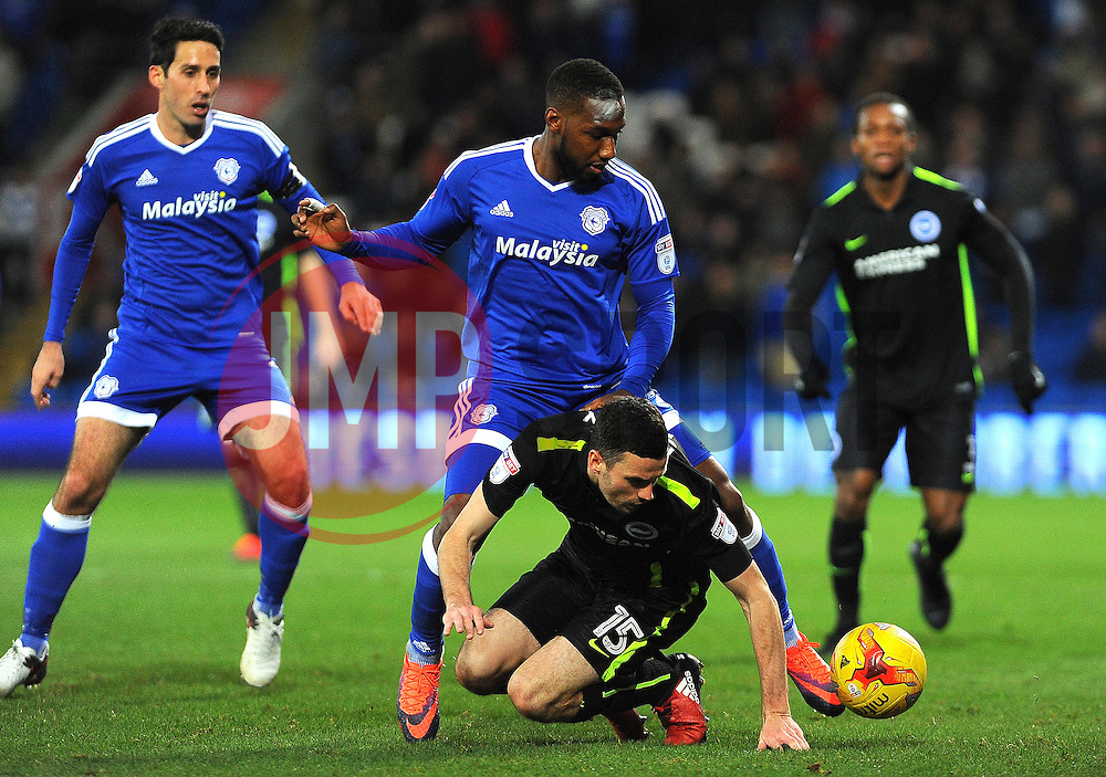 Jamie Murphy of Brighton & Hove Albion is bright to the ground by Junior Hoilett of Cardiff City- Mandatory by-line: Nizaam Jones/JMP - 03/12/2016 -  FOOTBALL - Cardiff City Stadium - Cardiff, Wales -  Cardiff City v Brighton and Hove Albion - Sky Bet Championship