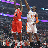 12 March 2012: Chicago Bulls shooting guard Ronnie Brewer (11) goes for the dunk over New York Knicks power forward Amare Stoudemire (1) during the first half of New York Knicks vs Chicago Bulls, at the United Center, Chicago, Illinois, USA.
