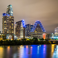 Austin Texas skyine at night picture along the Colorado River with Ashton building, Austonian building, 100 Congress building, and One Congress Plaza building. Austin is a major city in the Southwestern United States of America.