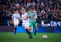 February 28, 2019 - Valencia, U.S. - VALENCIA, SPAIN - FEBRUARY 28: Daniel Wass, midfielder of Valencia CF competes for the ball with Andres Guardado, defender of Real Betis Balompie during the Copa del Rey match between Valencia CF and Real Betis Balompie at Mestalla stadium on February 28, 2019 in Valencia, Spain. (Photo by Carlos Sanchez Martinez/Icon Sportswire) (Credit Image: © Carlos Sanchez Martinez/Icon SMI via ZUMA Press)