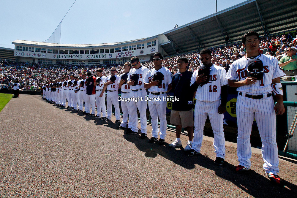 March 11, 2011; Fort Myers, FL, USA; Minnesota Twins second baseman Tsuyoshi Nishioka (1) and teammates stand for the national anthem prior to a  spring training exhibition game against the Boston Red Sox at Hammond Stadium.   Mandatory Credit: Derick E. Hingle