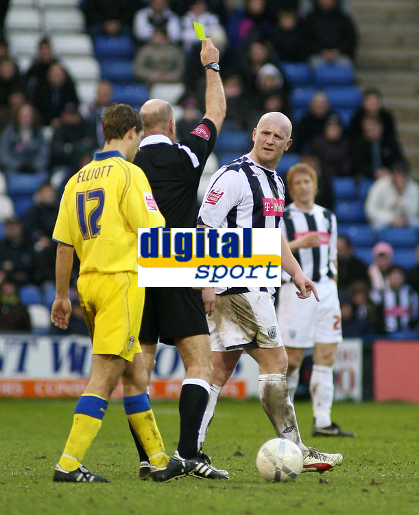 Photo: Mark Stephenson.<br />West Bromwich Albion v Leeds United. The FA Cup. 06/01/2007.<br />West Brom's goal scorer John Hartson is shown the yellow card.