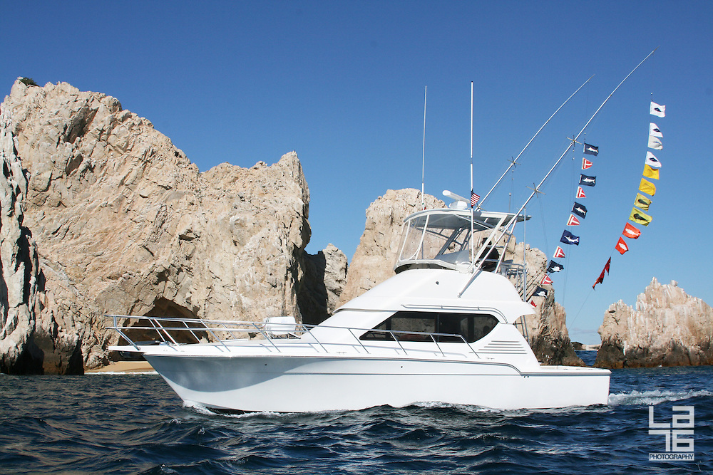 Sport fishing yacht at the rocks near the Land's End in Baja California Sur, Mexico
