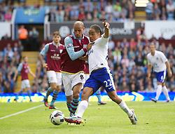 BIRMINGHAM, ENGLAND - Saturday, August 25, 2012: Everton's Steven Pienaar in action against Aston Villa's Karim El Ahmadi during the Premiership match at Villa Park. (Pic by David Rawcliffe/Propaganda)