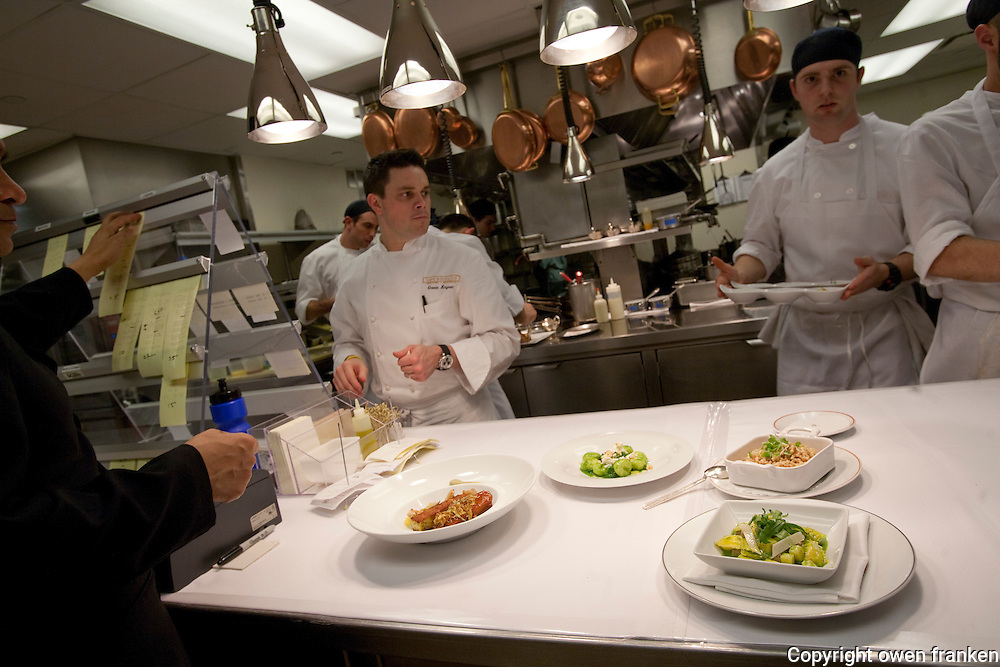 .the kitchen of Cafe Boulud, NYC...Chef Gavin Kaysen at left.