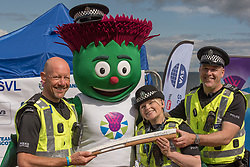 The Commonwealth Games Queen's Baton came to Portobello Beach and it still wasn't the biggest thing happening there. The Big Beach Busk, now in its eighth year was just getting underway when the Baton arrived at the beach volleyball courts by Portobello Baths where a Men's CEV Continental Tour competition was underway. Pictured: Local police with Clyde.<br /> <br /> <br /> © Jon Davey/ EEm