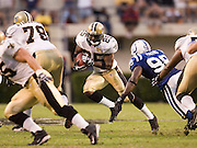 JACKSON, MS - AUGUST 26:  Running back Reggie Bush of the New Orleans Saints runs through the line against the Indianapolis Colts on August 26, 2006 at Veterans Memorial Field in Jackson, Mississippi.  (Photo by Wesley Hitt/Getty Images) *** Local Caption *** Reggie Bush