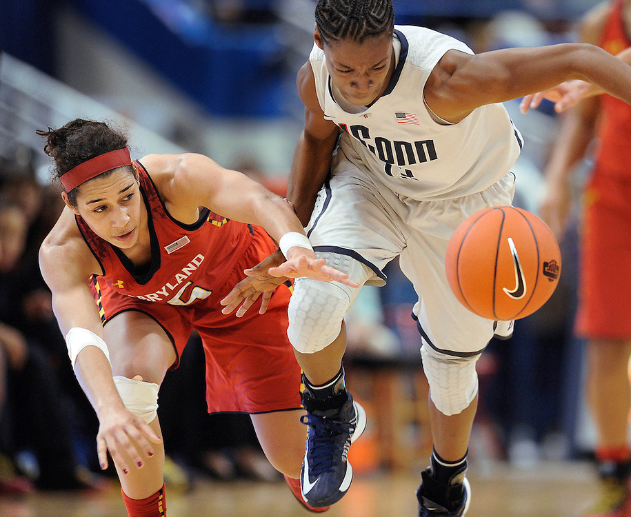 Connecticut's Brianna Banks, right, steals the ball from Maryland's Chloe Pavlech during the second half of an NCAA college basketball game in Hartford, Conn., Monday, Dec. 3, 2012. Connecticut won 63-48. (AP Photo/Jessica Hill)