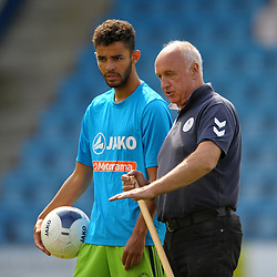 TELFORD COPYRIGHT MIKE SHERIDAN Telford groundsman Mick Conway chats to a Kings Lynn player during the National League North fixture between AFC Telford United and Kings Lynn Town at the Bucks Head on Tuesday, August 13, 2019<br />