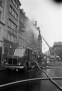 7/11/1967<br /> 11/7/1967<br /> 7 November 1967<br /> <br /> A fire completely destroyed Pigots on Grafton St. The street was closed and caused long delays in the early morning rush hour.<br /> <br /> Picture shows Dublin Fireman fighting the fire and Trinity College on the right
